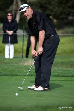 Bruce Bochy puts for par on the second hole at Pebble Beach