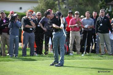 Javier Lopez uses an iron to drive towards the green at Pebble Beach