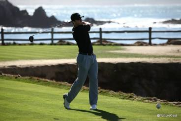 Buster Posey tees off on the 18th hole at Pebble Beach.