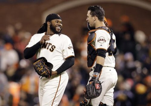 Johnny Cueto and Buster Posey of the San Francisco Giants