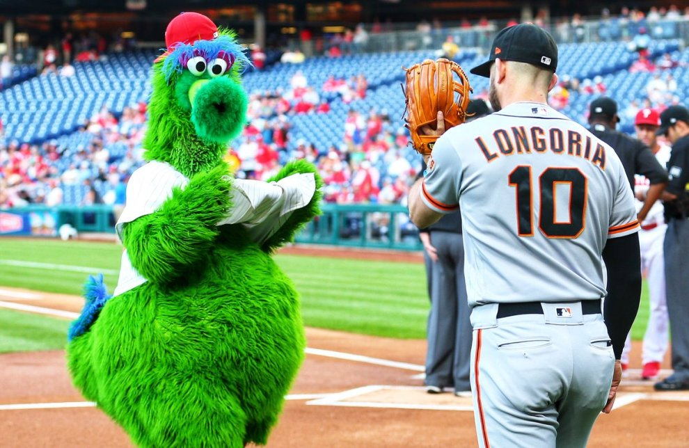Evan Longoria of the San Francisco Giants with the Phillie Phanatic