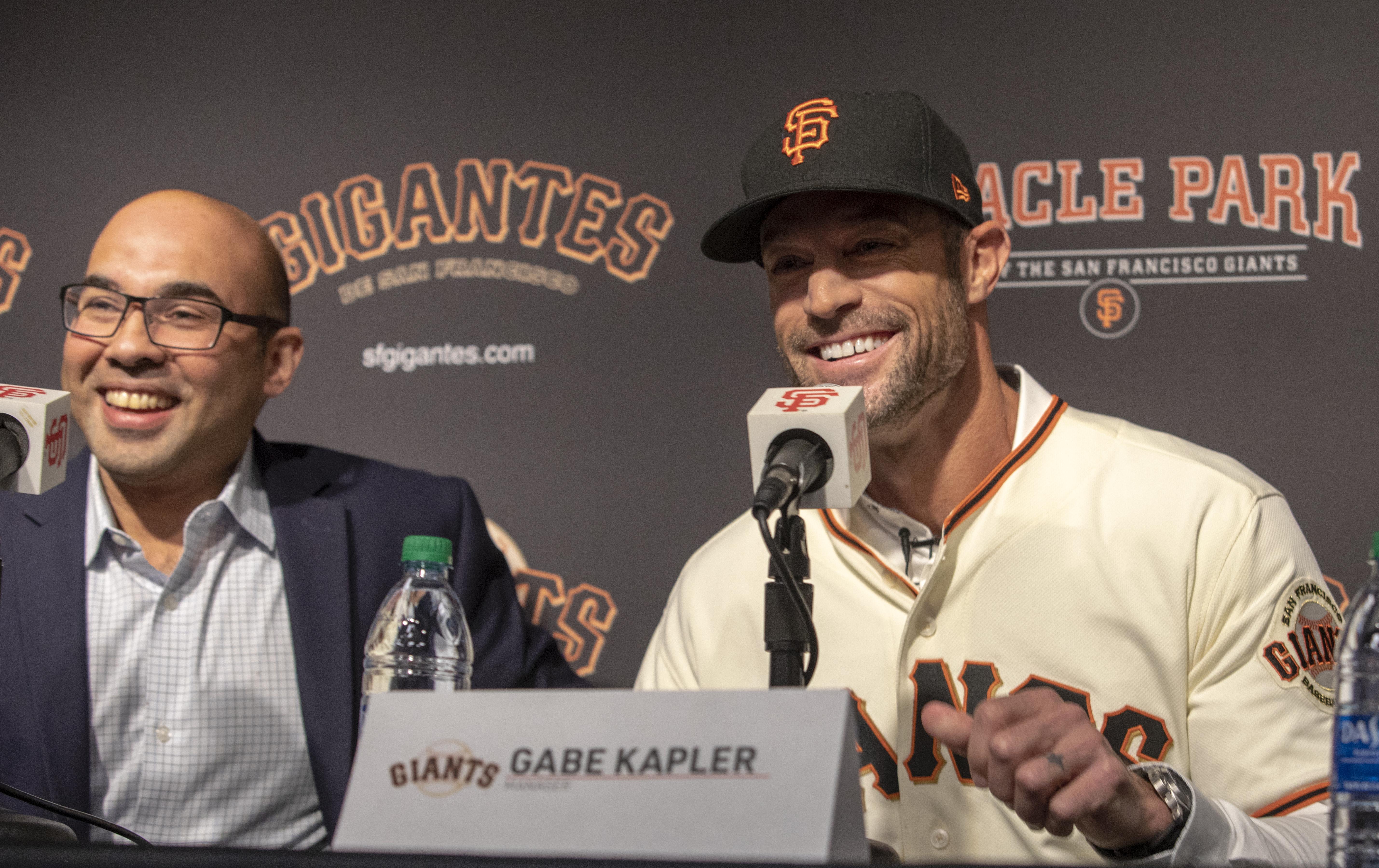 Gabe Kapler and Farhan Zaidi of the San Francisco Giants